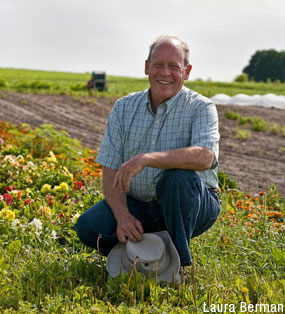 David Cohlmeyer smiling with his farm in the background