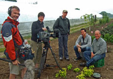 David doing a television appearance on a farm